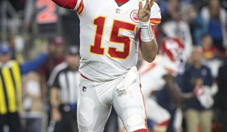 FILE - In this Nov. 19, 2018, file photo, Kansas City Chiefs quarterback Patrick Mahomes throws a pass during an NFL football game against the Los Angeles Rams, in Los Angeles. The Oakland Raiders host the Chiefs on Sunday. (AP Photo/Kyusung Gong, File)