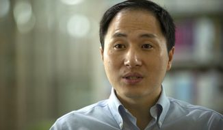 In this Oct. 10, 2018, photo, scientist He Jiankui speaks during an interview in Shenzhen in southern China's Guandong province. China's government on Thursday, Nov. 29, 2018, ordered a halt to work by a medical team that claimed to have helped make the world's first gene-edited babies. (AP Photo/Mark Schiefelbein)