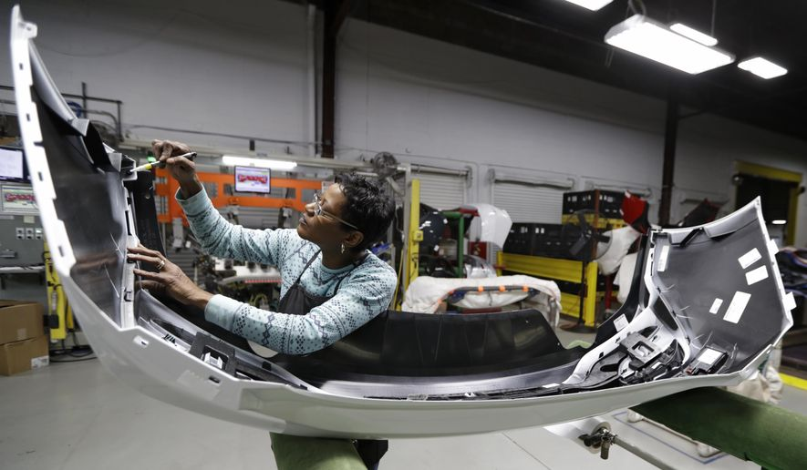 Youngstown Chevrolet >> Final inspector Mary Skinner inspects the rear end of a ...