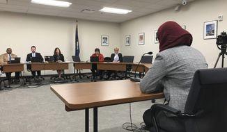 High school sophomore Sanaa Kahloon speaks against new minimum high school graduation requirements during a public hearing on Thursday, Nov. 29, 2018, in Frankfort, Kentucky.  (AP Photo/Adam Beam)