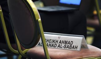 A name plate of Sheikh Ahmad al Fahad al Sabah, temporary ousted president of Association of National Olympic Committees (ANOC) is placed on a chair during the ANOC general assembly in Tokyo Thursday, Nov. 29, 2018. (AP Photo/Eugene Hoshiko)