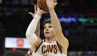 FILE - In this Oct. 24, 2018, file photo, Cleveland Cavaliers' Kyle Korver (26) shoots over Brooklyn Nets' Ed Davis (17) in the second half of an NBA basketball game in Cleveland. The Cavaliers will rebuild without Kyle Korver. Cleveland finalized its trade with Utah on Thursday, Nov. 29, 2018, by trading Korver to the Jazz for guard Alec Burks and two future second-round draft picks. Korver had hoped to be sent to a contender and the Cavs granted his wish.(AP Photo/Tony Dejak, File) **FILE**