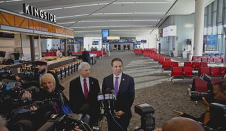 New York's Governor Andrew Cuomo, right, and Rick Cotton, left, executive director of the Port Authority, hold a press briefing inside the new Terminal B in LaGuardia Airport, Thursday Nov. 29, 2018, in New York. (AP Photo/Bebeto Matthews)