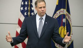 FILE - In this Oct. 12, 2018 file photo, Administrator of the National Aeronautics and Space Administration (NASA) Jim Bridenstine speaks during a news conference at the U.S. Embassy in Moscow, Russia. America's next moon landing will be made by private companies, not NASA. Bridenstine announced Thursday, Nov. 29 that nine U.S. companies will compete in delivering experiments to the lunar surface.  (AP Photo/Pavel Golovkin, File)