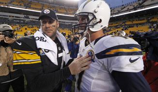 FILE - In this Dec. 9, 2012, file photo, Pittsburgh Steelers quarterback Ben Roethlisberger (7) talks with San Diego Chargers quarterback Philip Rivers (17) after the Chargers won 34-24  in an NFL football game in Pittsburgh. The scoreboard might explode at Heinz Field as Class of 2004 QBs Philip Rivers and Ben Roethlisberger light it up on Sunday. (AP Photo/Gene J. Puskar, File)