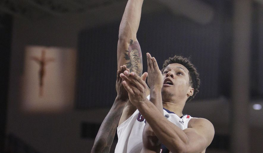 Gonzaga forward Brandon Clarke, right, shoots while defended by North Dakota State guard Vinnie Shahid during the second half of an NCAA college basketball game in Spokane, Wash., Monday, Nov. 26, 2018. (AP Photo/Young Kwak)