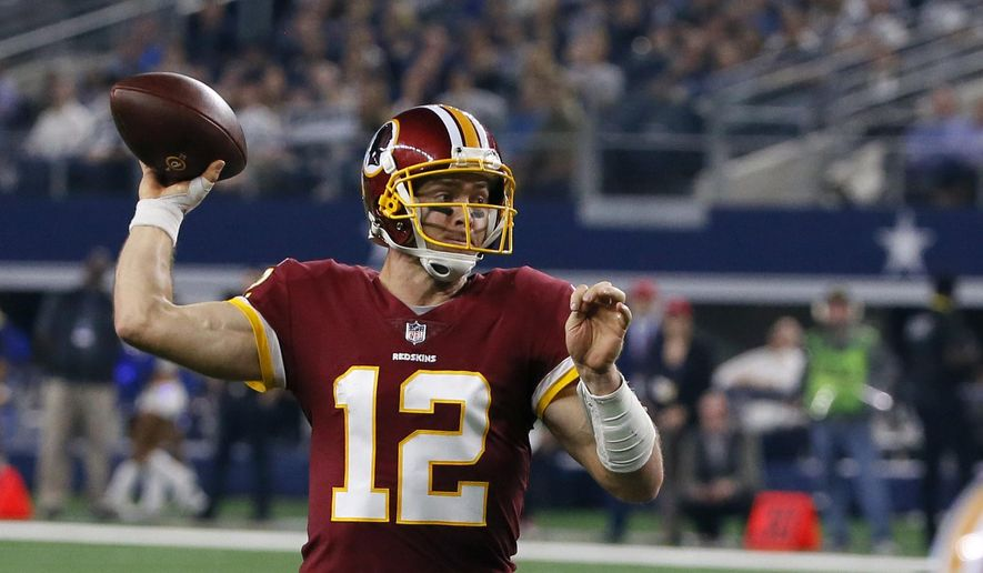 FILE - In this Nov. 22, 2018, file photo, Washington Redskins quarterback Colt McCoy attempts to pass during the second half of an NFL football game against the Dallas Cowboys, in Arlington, Texas. The  Philadelphia Eagles (5-6) host the Washington Redskins (6-5) on Monday night. (AP Photo/Roger Steinman, File)