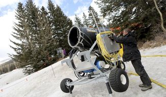 FILE - In this file photo taken on March 3, 2014, snowmaking supervisor Carl McKenna explains the features of a snowmaking machine at the Arizona Snowbowl near Flagstaff, Ariz. The Arizona Supreme Court is scheduled to rule on the Hopi Tribe's challenge to snowmaking at a northern Arizona ski resort. The decision is expected mid-morning Thursday, Nov. 29, 2018. The high court has been considering whether a lower court created a new category of special harm for public nuisance claims. (Jake Bacon/Arizona Daily Sun via AP, File)