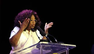 Oprah Winfrey gives her speech after paying tribute to Nelson Mandela and promoting gender equality at an event at University of Johannesburg in Soweto, South Africa, Thursday, Nov. 29, 2018. The former talk show host on Thursday joined Graca Machel, Mandela's widow and an advocate of women's and children's rights, at the Soweto campus of the University of Johannesburg. (AP Photo/Themba Hadebe)