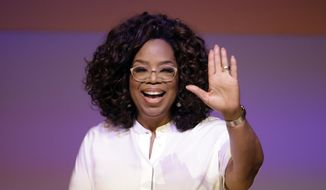 Oprah Winfrey waves the audience during a tribute to Nelson Mandela and promoting gender equality event at University of Johannesburg in Soweto, South Africa, Thursday, Nov. 29, 2018. (AP Photo/Themba Hadebe)