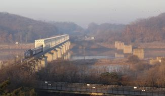 A South Korean train runs on the rail track, which the two Koreas hope to eventually use as an international transport link, near to the border village of Panmunjom in North Korea, in Paju, South Korea, Friday, Nov. 30, 2018.  The two Koreas plan to start an 18-day joint survey Friday, of the North Korean railroad sections along the country's eastern and western coasts, as they move to reduce tensions across the heavily armed border. (AP Photo/Ahn Young-joon)