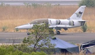 This photo released by Conflict Armament Research taken in Feb. 2017 is said by them to show an L-39 jet trainer/ground attack aircraft at the international airport in Juba, South Sudan. The Conflict Armament Research report released Thursday, Nov. 29, 2018, says Uganda diverted European weapons to South Sudan's military despite an EU arms embargo and asks how a U.S. military jet ended up deployed in South Sudan in possible violation of arms export controls.(Conflict Armament Research via AP)