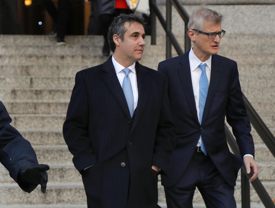 """Michael Cohen, left, walks out of federal court with his attorney Guy Petrillo, Thursday, Nov. 29, 2018, in New York, after pleading guilty to lying to Congress about work he did on an aborted project to build a Trump Tower in Russia.  Cohen, President Donald Trumps former lawyer, told the judge he lied about the timing of the negotiations and other details to be consistent with Trump's """"political message."""" (AP Photo/Julie Jacobson)"""