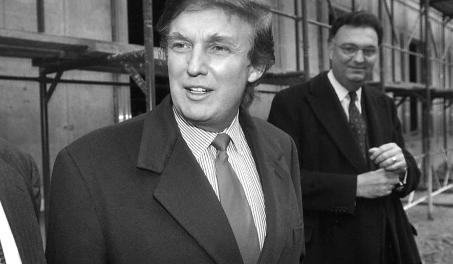 FILE - In this Nov. 5, 1996 file photo, American real estate mogul Donald Trump, left, checks out sites in Moscow, Russia, for luxury residential towers. Trump's decades-long dream of building a luxury tower in the heart of Moscow flared and fizzled several times over the years, most recently when his presidential campaign was gaining momentum. That latest plan led his former lawyer Michael Cohen to plead guilty to a charge of lying to congressional investigators about key details in the negotiations, most notably that those talks stretched far deeper into the 2016 campaign than previously thought. (AP Photo/Igor Tabakov, File)
