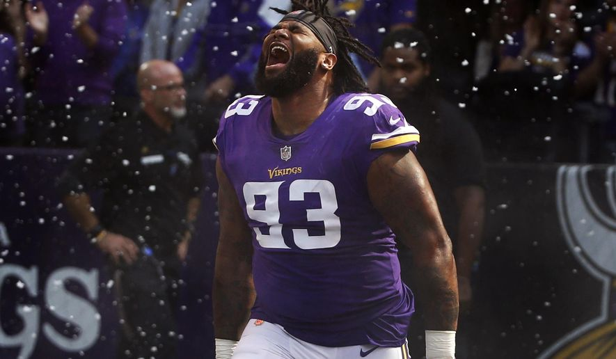 FILE - In this Sept. 23,2018, file photo, Minnesota Vikings defensive tackle Sheldon Richardson runs onto the field before an NFL football game against the Buffalo Bills in Minneapolis. Minnesota's big splash of the offseason was the addition of quarterback Kirk Cousins, but the value of signing defensive tackle Sheldon Richardson as a free agent can't be overlooked. He's fourth among NFL interior defensive linemen in quarterback pressures. (AP Photo/Bruce Kluckhohn, File)