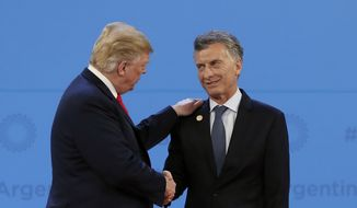 Argentine President Mauricio Macri has a good personal relationship with President Trump. His economy, which he promised to jump-start, struggles in part because a Trump tax-cut-fueled boom in the U.S. and a rising dollar have sucked up investment money that once went to Argentina and other hot emerging markets. (Associated Press/File)