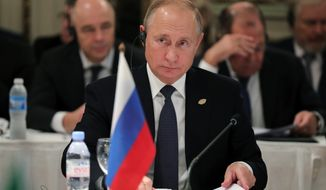 Russian President Vladimir Putin attends the G-20 summit in Buenos Aires, Argentina, Friday, Nov. 30, 2018. Leaders from the Group of 20 industrialized nations are meeting in Buenos Aires for two days starting today. (Mikhail Klimentyev, Sputnik, Kremlin Pool Photo via AP)