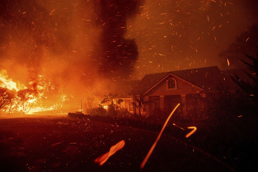 n this Thursday, Nov. 8, 2018, photo, the Camp Fire rages through Paradise, Calif. U.S. Interior Secretary Ryan Zinke says wildfires in California in 2018, released roughly the same amount of carbon emissions as are produced each year to provide electricity to the state. (AP Photo/Noah Berger) **FILE**
