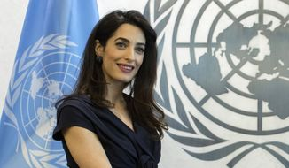 In this Friday, March 10, 2017, file photo, human rights lawyer Amal Clooney poses for a photo at the United Nations headquarters. (AP Photo/Mary Altaffer, File)