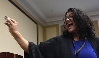 Rep.-elect Rashida Tlaib, D-Mich., reacts after drawing her number during the Member-elect room lottery draw on Capitol Hill in Washington, Friday, Nov. 30, 2018. Tlaib drew 8 out of 85, which determines the order in which she gets to select her new Capitol Hill office. (AP Photo/Susan Walsh) ** FILE **