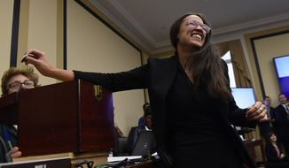 Rep.-elect Alexandria Ocasio-Cortez, D-N.Y., draws her number during the Member-elect room lottery draw on Capitol Hill in Washington, Friday, Nov. 30, 2018. Ocasio-Cortez drew 40 out of 85, which determines the order in which she gets to select her new Capitol Hill office. (AP Photo/Susan Walsh) ** FILE **