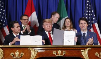 President Donald Trump, Canada's Prime Minister Justin Trudeau, right,  and Mexico's President Enrique Pena Neto, left, participate in the USMCA signing ceremony, Friday, Nov. 30, 2018 in Buenos Aires, Argentina, in this file photo. (AP Photo/Pablo Martinez Monsivais) **FILE**