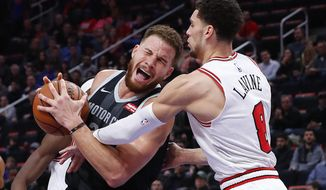 Chicago Bulls guard Zach LaVine (8) fouls Detroit Pistons forward Blake Griffin (23) during the second half of an NBA basketball game in Detroit, Friday, Nov. 30, 2018. (AP Photo/Paul Sancya)