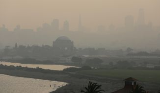FILE - In this Nov. 19, 2018 file photo, The Palace of Fine Arts and the San Francisco city skyline are obscured due to smoke and haze from wildfires. U.S. Interior Secretary Ryan Zinke says wildfires in California in 2018 released roughly the same amount of carbon emissions as are produced each year to provide electricity to the state. (AP Photo/Eric Risberg, File)