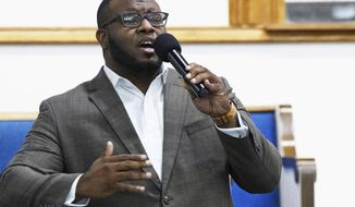 FILE - This Sept. 21, 2017, file photo provided by Harding University in Search, Ark., shows Botham Jean leading worship at a university presidential reception in Dallas. Jean was shot and killed by Dallas police officer Amber Guyger in his apartment in Dallas. The former Dallas police officer has been indicted on a murder charge announced Friday, Nov. 30, 2018. Guyger was arrested days after the Sept. 6 shooting that killed 26-year-old Jean, who was from the Caribbean island nation of St. Lucia. (Jeff Montgomery/Harding University via AP, File)