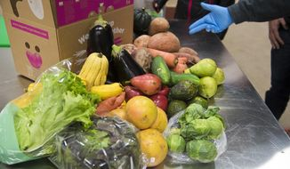 In this Nov. 13, 2018 photo, produce is displayed at Imperfect Produce in Severn, Md. The company delivers fruit and vegetables that have been rejected by grocery stores for not fitting the cosmetic standard. (Joshua McKerrow/The Baltimore Sun via AP)