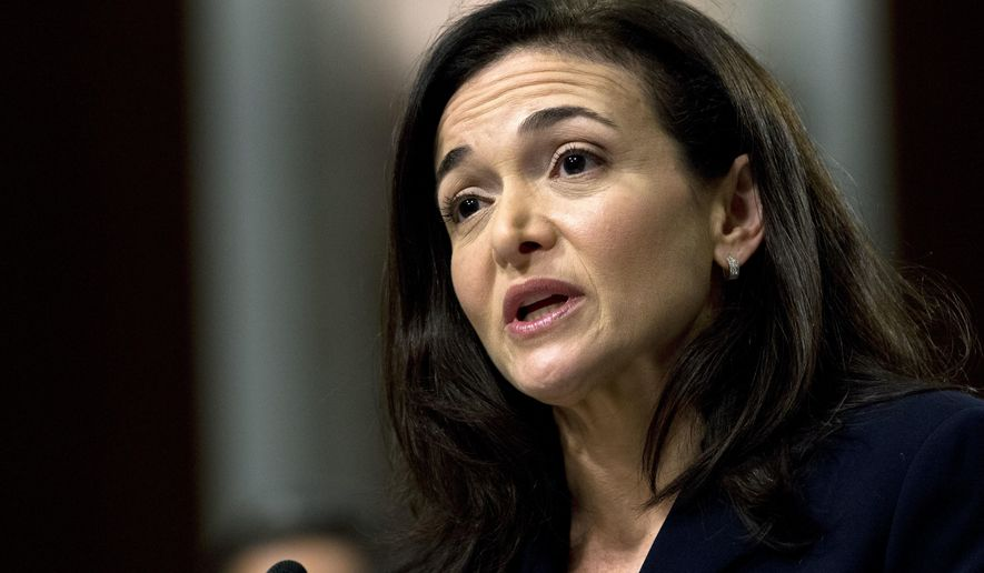 FILE- In this Sept. 5, 2018, file photo Facebook COO Sheryl Sandberg testifies before the Senate Intelligence Committee hearing on Capitol Hill in Washington. Having already acknowledged that it did opposition research on George Soros, Facebook says No. 2 Sandberg had asked staff if the billionaire philanthropist had financial motivations against the company. The Friday, Nov. 30, statement is in response a New York Times article that describes Sandberg asking Facebook staff to look into Soros' financial interests in speaking out against the company in January. (AP Photo/Jose Luis Magana)