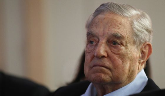"FILE- In this May 29, 2018, file photo George Soros, Founder and Chairman of the Open Society Foundations listens to the conference after his speech entitled ""How to save the European Union"" as he attends the European Council On Foreign Relations Annual Council Meeting in Paris. (AP Photo/Francois Mori, File) **FILE**"