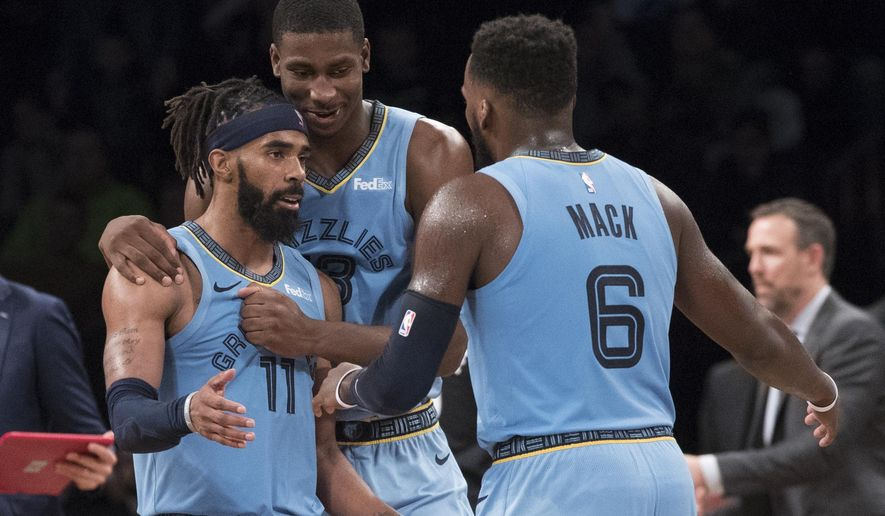 Memphis Grizzlies guard Mike Conley (11), guard Shelvin Mack (6) and forward Jaren Jackson Jr. react during overtime of the team's NBA basketball game against the Brooklyn Nets, Friday, Nov. 30, 2018, in New York. The Grizzlies won 131-125. (AP Photo/Mary Altaffer)