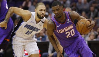 Phoenix Suns forward Josh Jackson (20) drives past Orlando Magic guard Evan Fournier during the second half of an NBA basketball game Friday, Nov. 30, 2018, in Phoenix. The Magic defeated the Suns 99-85. (AP Photo/Rick Scuteri)