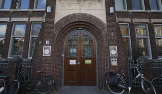 Exterior view of the Bethel church in The Hague, Netherlands, Friday, Nov. 30, 2018, where for more than a month, a rotating roster of preachers and visitors has been leading a non-stop, round-the-clock service at a small Protestant chapel in a quiet residential street in The Hague in an attempt to prevent the deportation of a family of Armenian asylum seekers. (AP Photo/Peter Dejong)