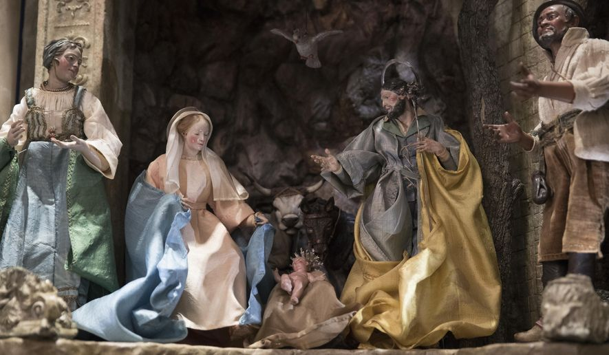 In this Nov. 27, 2017 file photo, a detail of the baby Jesus is seen in a Nativity Scene in the East Room during a media preview of the 2017 holiday decorations at the White House in Washington.  (AP Photo/Carolyn Kaster, File)  **FILE**
