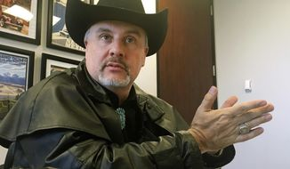 In this April 26, 2018 file photo, Gavin Clarkson of Lac Cruces, N.M., speaks at the Albuquerque bureau of The Associated Press. A District of Columbia clerk refused to accept Clarkson's state driver's license for a marriage license because she and her supervisory believed New Mexico was a foreign country. (AP Photo/Russell Contreras, File)