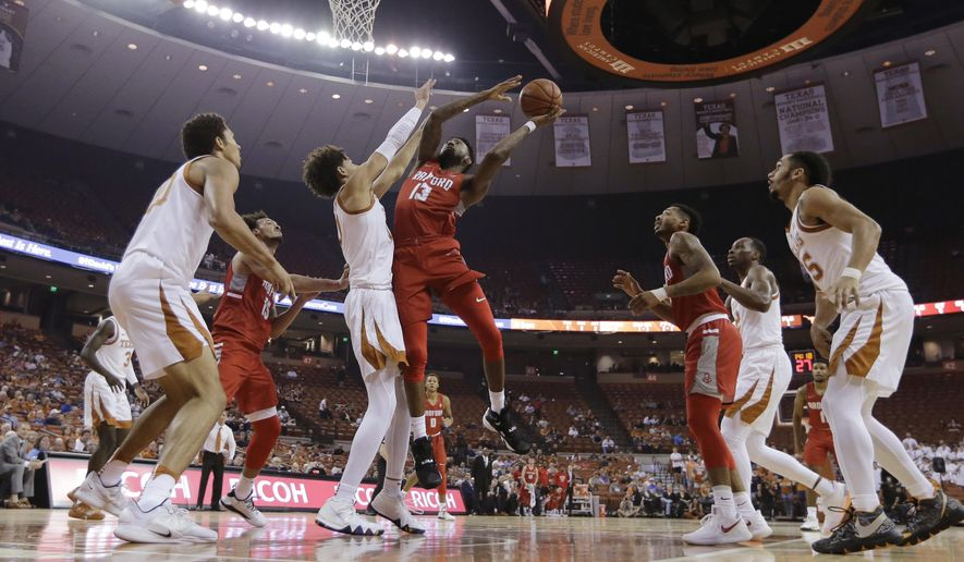 Radford forward Leroy Butts IV (13) tries to shoot over Texas forward Jaxson Hayes during the first half of an NCAA college basketball game Friday, Nov. 30, 2018, in Austin, Texas. (AP Photo/Eric Gay)