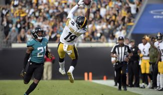FILE - In this Sunday, Nov. 18, 2018, file photo, Pittsburgh Steelers wide receiver JuJu Smith-Schuster (19) catches a pass in front of Jacksonville Jaguars cornerback A.J. Bouye (21) during the second half of an NFL football game in Jacksonville, Fla. The 22-year-old leads Pittsburgh in receptions and yards receiving heading into a showdown with the Los Angeles Chargers. (AP Photo/Phelan M. Ebenhack, File)