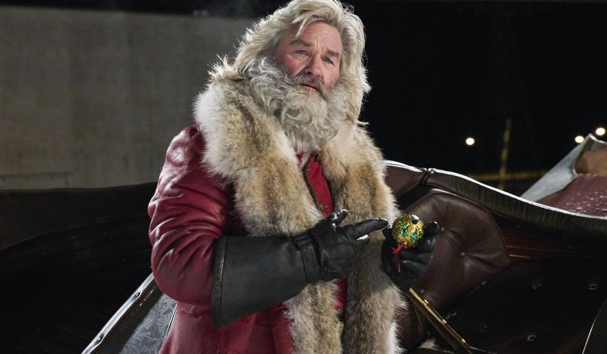 "This image released by Netflix shows Kurt Russell in a scene from ""The Christmas Chronicles,"" currently streaming on Netflix. (Michael Gibson/Netflix via AP)"