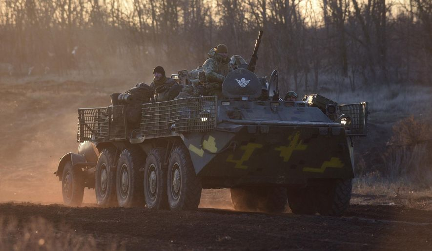 Ukrainian soldiers drive APCs near Urzuf, south coast of Azov sea, eastern Ukraine, Thursday, Nov. 29, 2018. Ukraine put its military forces on high combat alert and announced martial law this week after Russian border guards fired on and seized three Ukrainian ships in the Black Sea. (AP Photo/Evgeniy Maloletka)