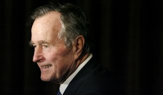 In this Feb. 6, 2007, file photo, former President George H.W. Bush arrives at the 2007 Ronald Reagan Freedom Award gala dinner held in his honor in Beverly Hills, Calif. Bush has died at age 94. Family spokesman Jim McGrath says Bush died shortly after 10 p.m. Friday, Nov. 30, 2018, about eight months after the death of his wife, Barbara Bush. (AP Photo/Matt Sayles, File)