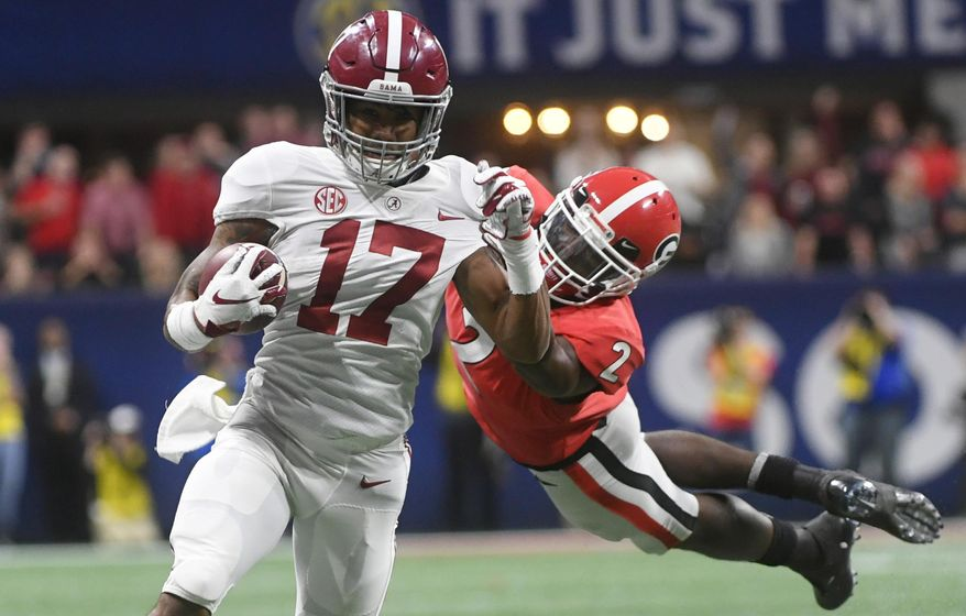 Georgia defensive back Richard LeCounte (2) misses the tackle on Alabama wide receiver Jaylen Waddle (17) during the second half of the Southeastern Conference championship NCAA college football game, Saturday, Dec. 1, 2018, in Atlanta. Waddle scored a touchdown on the play. (AP Photo/John Amis)