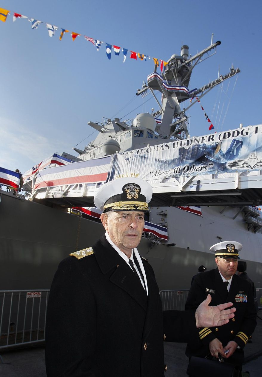 Vice Chief of Naval Operations, Admiral William Moran describes the function of the USS Thomas Hudner prior to its commissioning ceremony Saturday Dec. 1, 2018, in Boston.  The Maine-built Arleigh Burke-class destroyer is named in honor of Thomas Hudner, a Fall River native and longtime Concord resident who was awarded the Medal of Honor by President Harry Truman for crash-landing his plane to try to save the life of Ensign Jesse Brown during the Battle of Chosin Reservoir in December 1950.  (Paul Connors/The Boston Herald via AP)