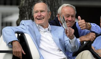 FILE - In this Oct. 22, 2010, file photo, Former President George H. W. Bush, left, and golfing great Arnold Palmer acknowledge the gallery at the Champions Tour golf tournament in The Woodlands, Texas. Bush, who died Friday,  Nov. 30, 2018, was one of two presidents inducted into the World Golf Hall of Fame. (AP Photo/Pat Sullivan, File)