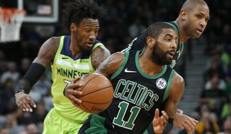 Boston Celtics' Kyrie Irving, center, drives as Minnesota Timberwolves' Robert Covington, left, pursues during the first half of an NBA basketball game Saturday, Dec. 1, 2018, in Minneapolis. At right rear is Celtics' Al Horford. (AP Photo/Jim Mone)