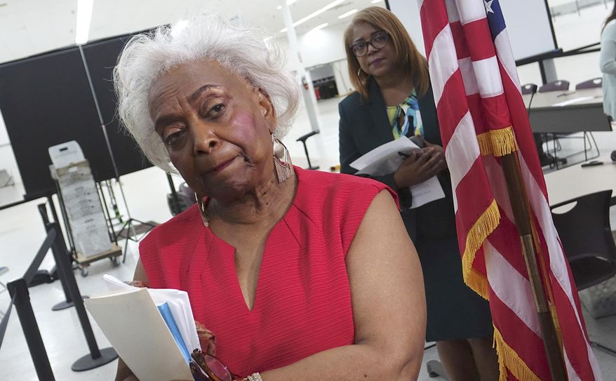 Broward County Supervisor of Elections Brenda Snipes listens to questions from the media, Sunday, Nov. 18, 2018, at the Broward Supervisor of Elections office in Lauderhill, Fla. Broward County reported their recount results with 52 minutes to spare Sunday. (Joe Cavaretta/South Florida Sun-Sentinel via AP)