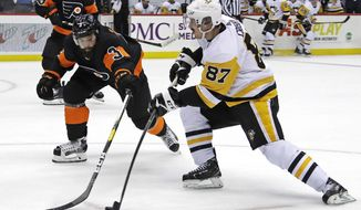 Sidney Crosby (87) has a shot deflected by Philadelphia Flyers' Radko Gudas (3) during the second period of an NHL hockey game in Pittsburgh, Saturday, Dec. 1, 2018. (AP Photo/Gene J. Puskar)