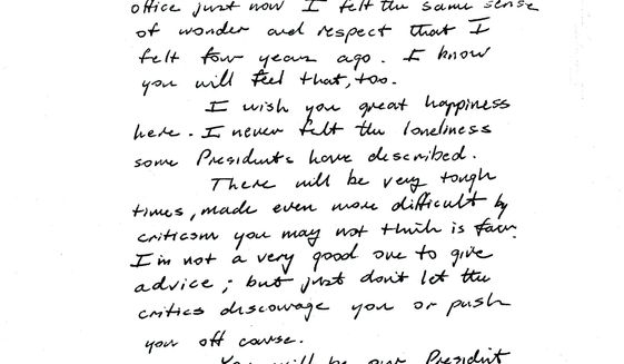 This image provided by the George H.W. Bush Presidential Library and Museum shows a note written by George H.W. Bush to Bill Clinton.   (George H.W. Bush Presidential Library and Museum via AP)