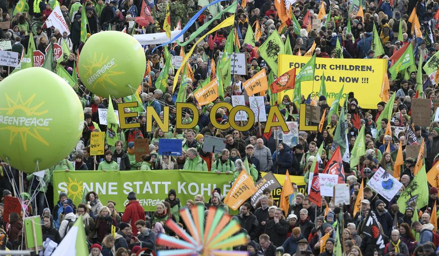 Demonstrators take part in a climate demonstration in Cologne, Germany, Saturday, Dec. 1, 2018. Thousands of people are marching in Berlin and Cologne to demand that Germany make a quick exit from coal-fired energy, a day before a U.N. climate summit opens in neighboring Poland. (Henning Kaiser/dpa via AP)